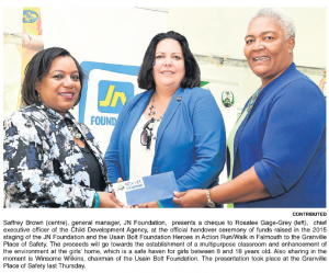 JN Foundation presents a cheque to Child Development Agency
