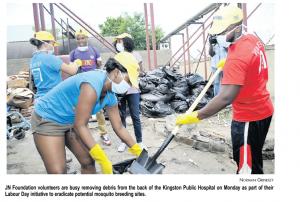 JN Foundation volunteers are busy removing debris